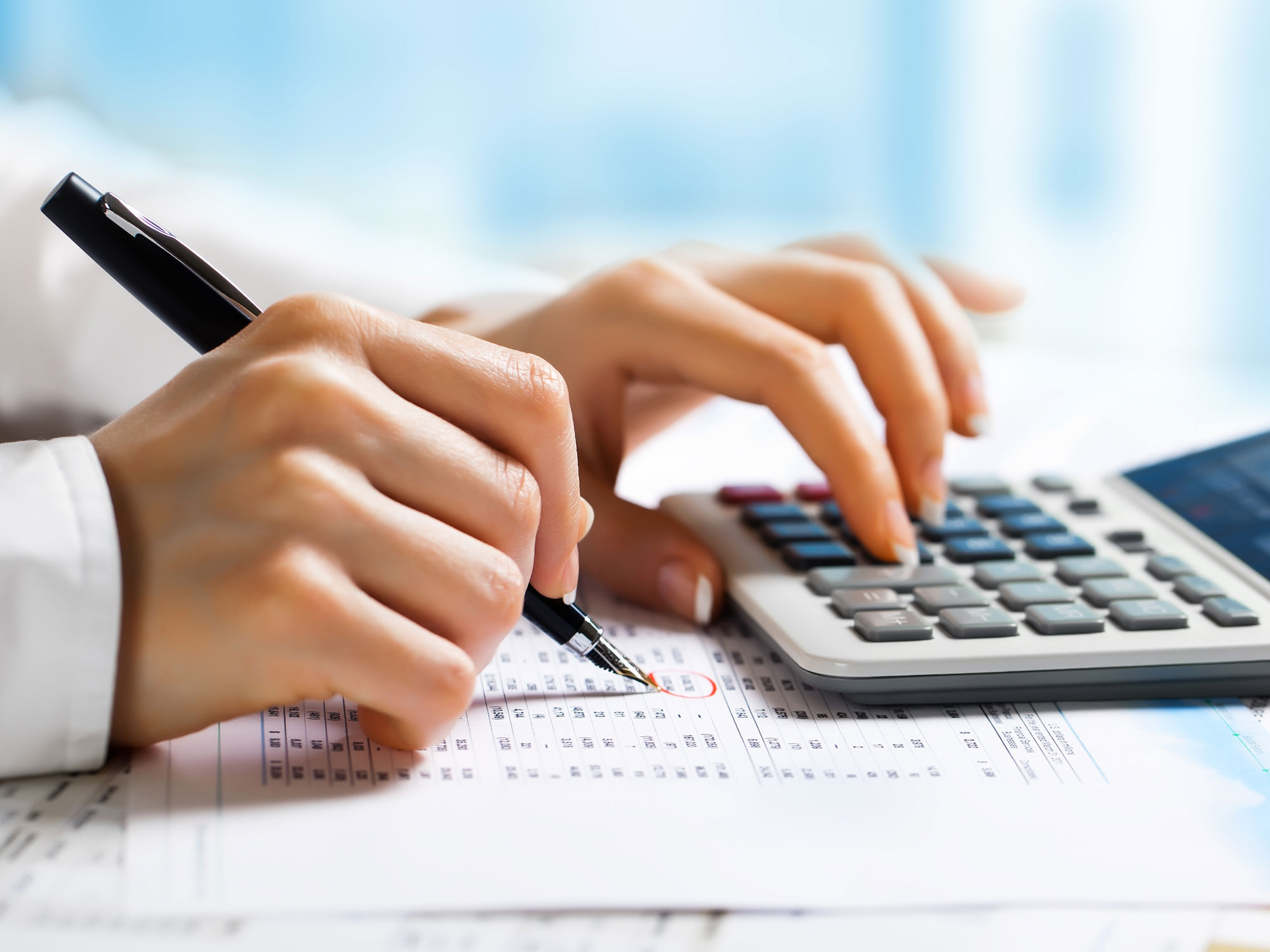 business person doing calculations using a calculator