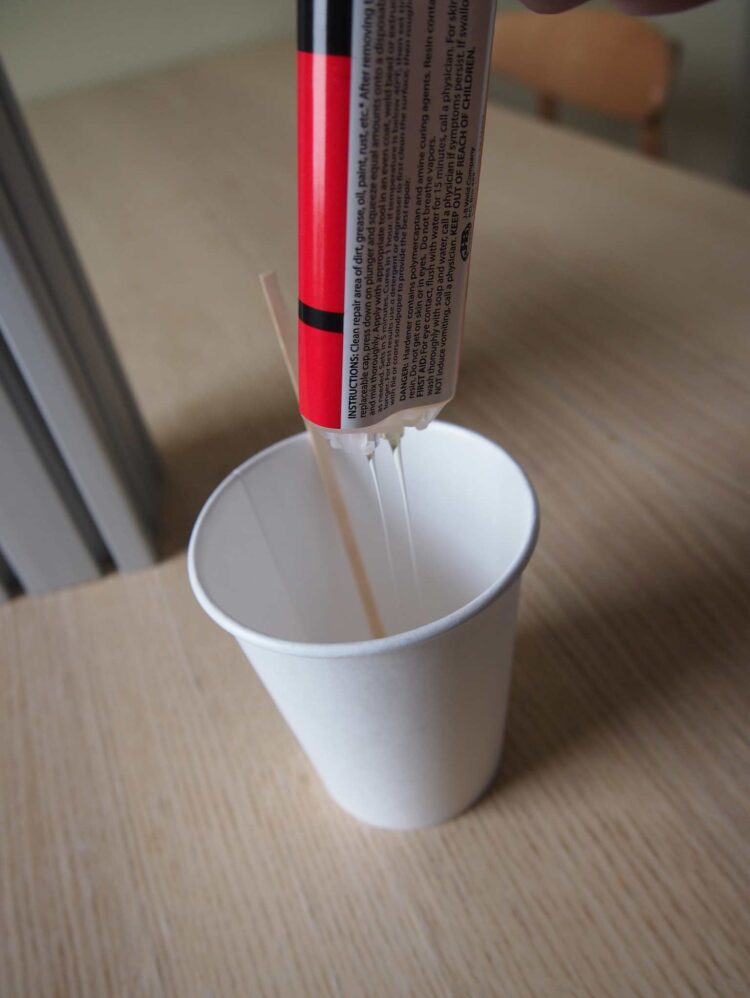 5   Squeeze all of the epoxy into a disposable cup.