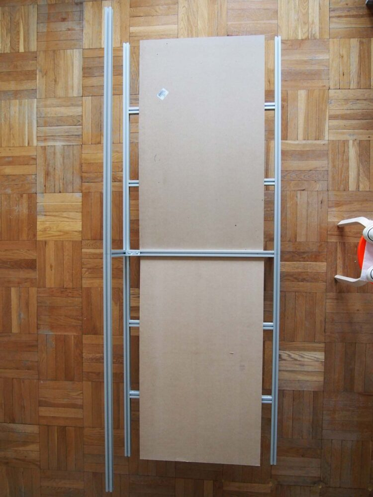 11   Stand the frame on its feet and place the MDF boards in the channels in the middle of the frame.