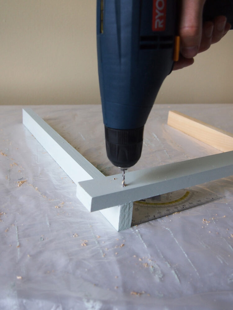 22   Drill two holes, countersink the holes, and screw the pieces together. As in step 21, place a second piece at the other end of the upper piece. Drill and screw in place.