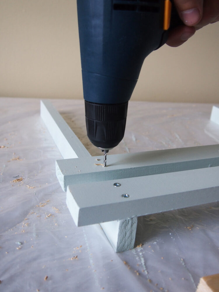 24   Align with the edge of the first top piece, hold the wood in place, then drill and countersink two holes on each end of the piece you placed in step 23.