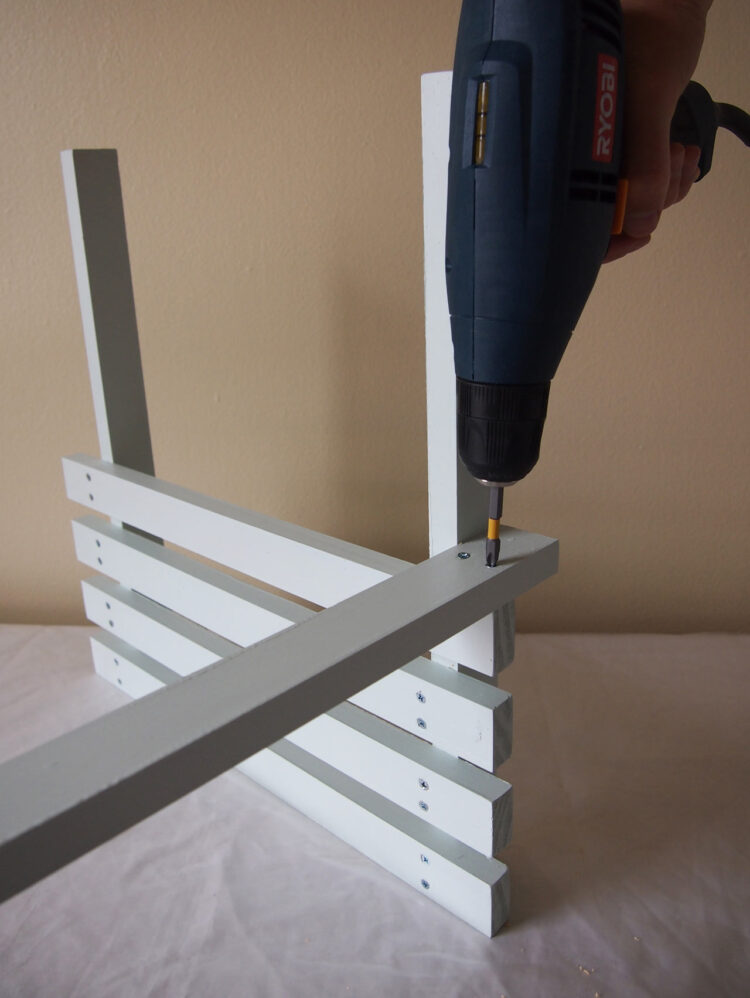 28   With 2 more screws, secure the piece you added in step 27 to the lowest of the 4 slats.