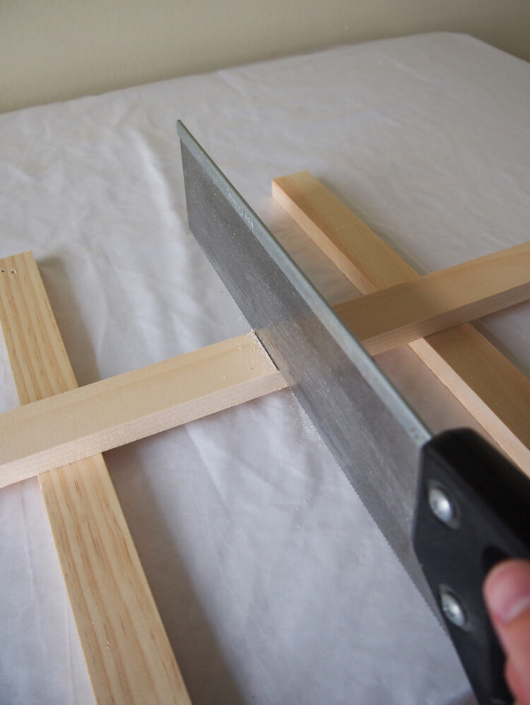 2   Elevate the wood from the table and saw along the line you just made. Repeat step 1 and 2 until you have 30 pieces (31 pieces if using 18mm x 34mm wood).