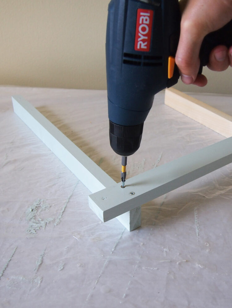 6   Using a larger drill bit, countersink the holes. Then screw the two pieces together with wood screws until the screw heads are flush with the wood.