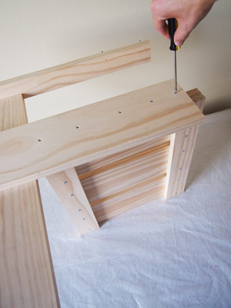 24   With the piece from step 22 on its side, place the arm rest piece that aligns with your holes on top. Countersink the 5 holes and add screws.