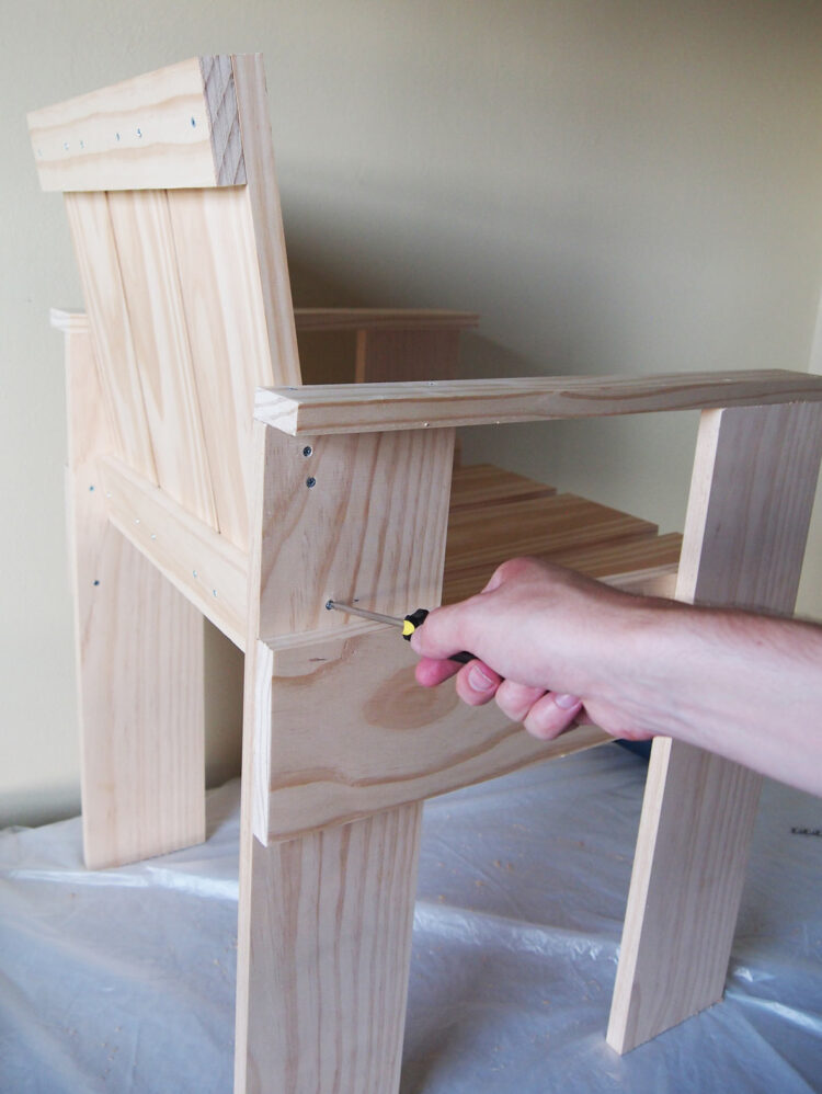 27   Align the piece from step 23 with it's holes on the arm rests. Countersink and screw in the 6 screws to join the pieces.