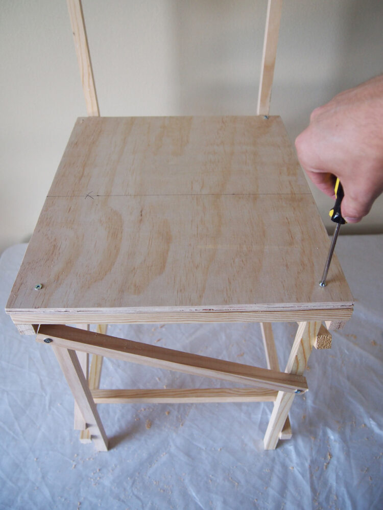 15   Place the 18in x 15in (450mm x 380mm) piece on the seat area and drill + screw it into place with 4 screws.
