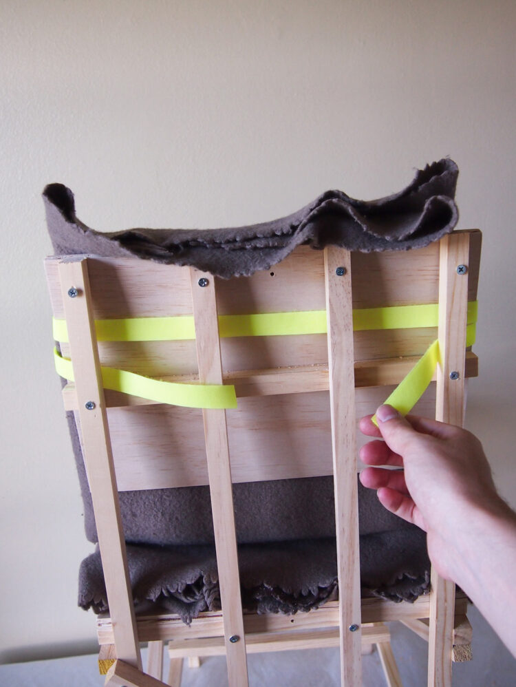 19   Wrap one side of your Hook and Loop (or Velcro), with the flat side exposed, around the top of the back rest twice.
