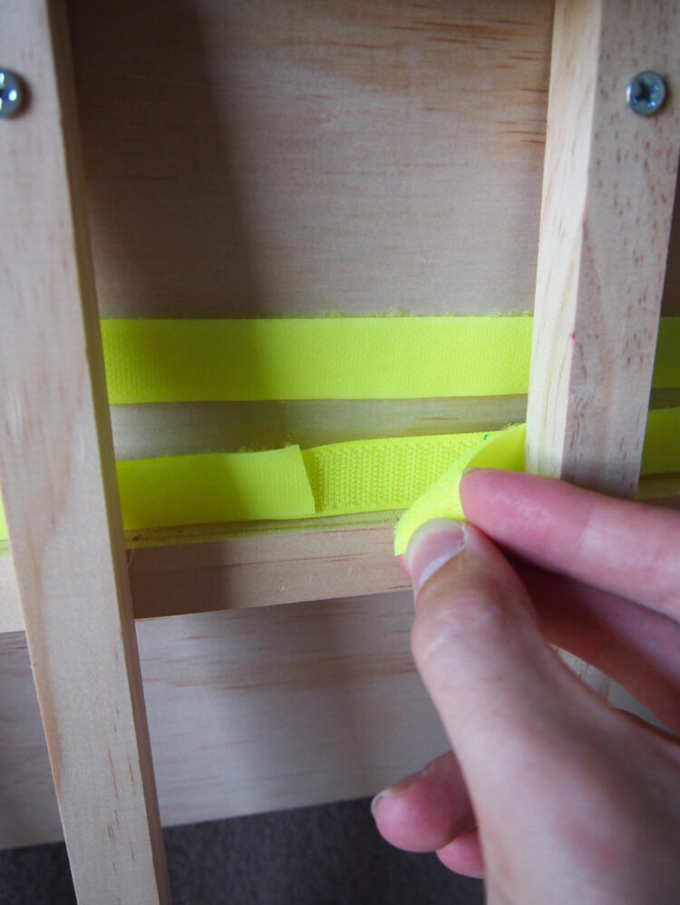 20   Pull tight, and insert a small piece of the opposite side of the Hook and Loop (or Velcro) underneath to secure.