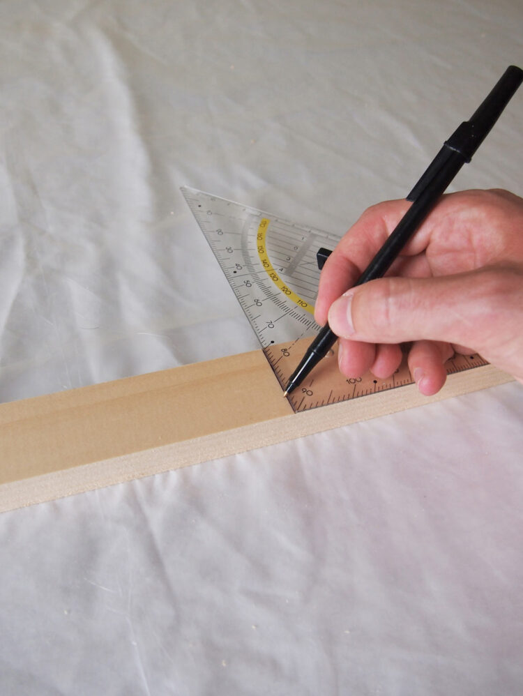 1   Using a square tool and tape measure, measure and mark these lengths of wood: 2 pieces 34.5in (88cm) long, 6 pieces 27.5in (70cm) long, 2 pieces 15.75in (40cm), 2 pieces 17.75in (45cm), 10 pieces 20in (50cm) long.