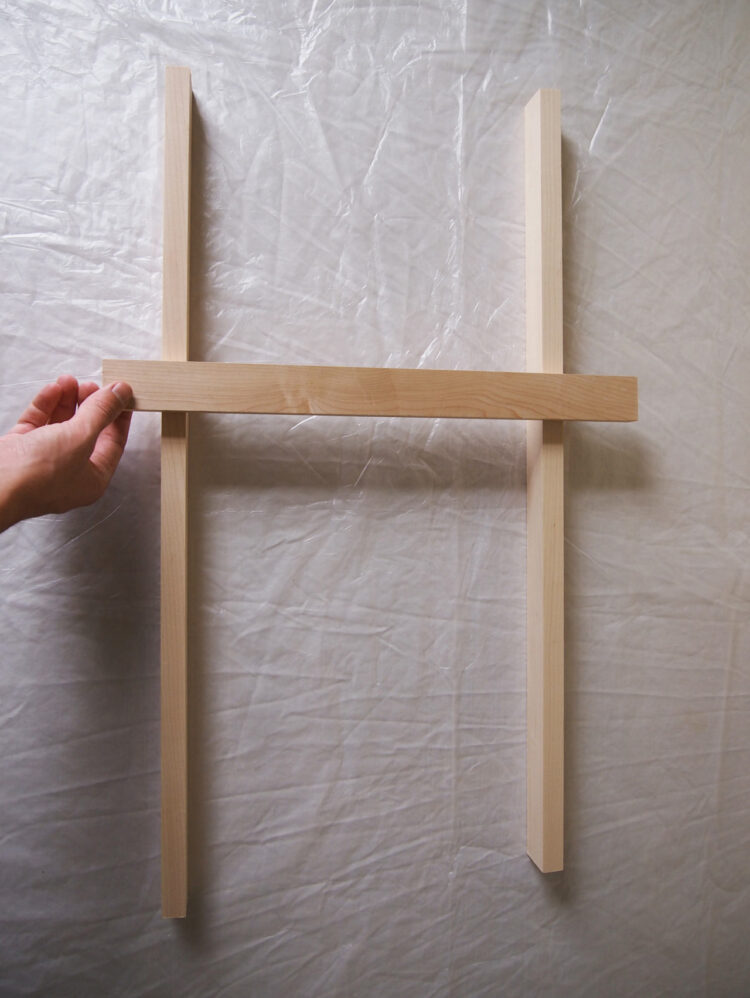 3   Arrange two 27.5in (70cm) long pieces vertically, and one 17.75in (45cm) piece horizontally, as photographed.