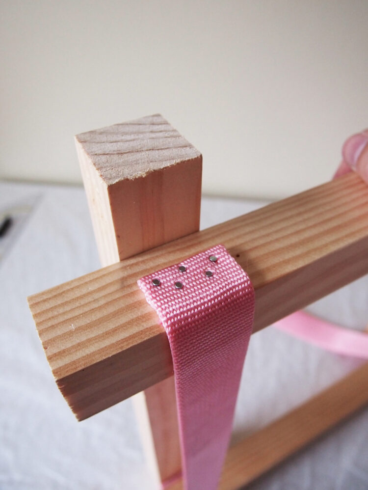 13   Add 4 more nails, and repeat the process in steps 11-13 to secure the other strap.
