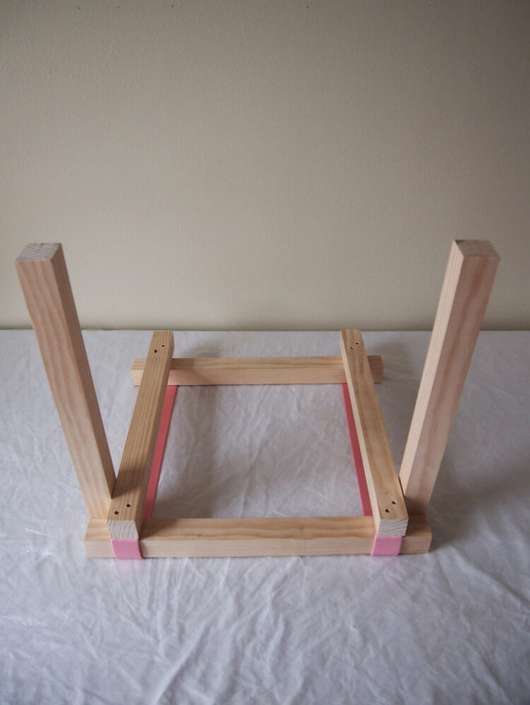 14   Position two 18in (46cm) long pieces vertically at the lower corners of the frame.