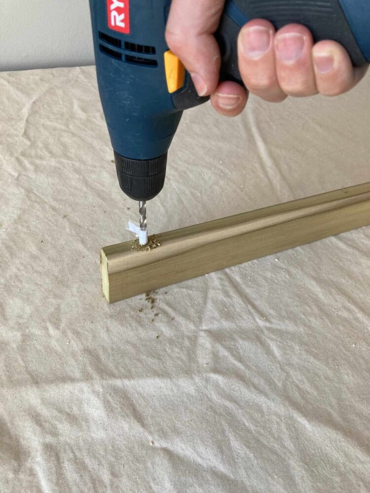 9   As in step 5, drill holes along the center of the spine of the new piece of wood where the dowels line up.