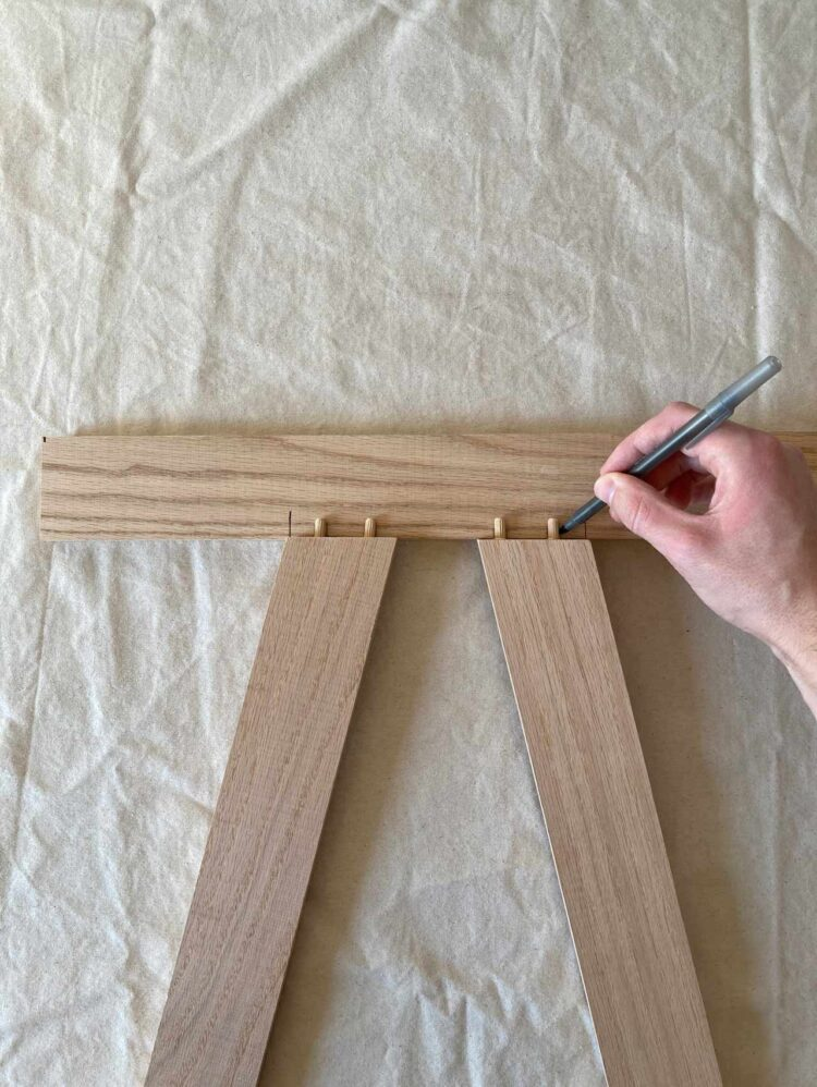 10   Line up your pieces from step 8 inside of your marks from step 9, as pictured. Mark where the dowel pins lie.