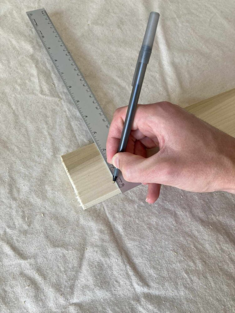 3   A couple of inches from the end of a 77in (196cm) long piece, make a mark 3/8in (1cm) from the long edge.