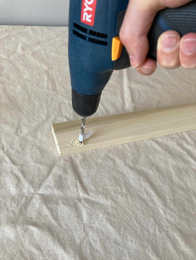 5   In the spot of the pilot hole, drill a hole up to the mark made in step 4.