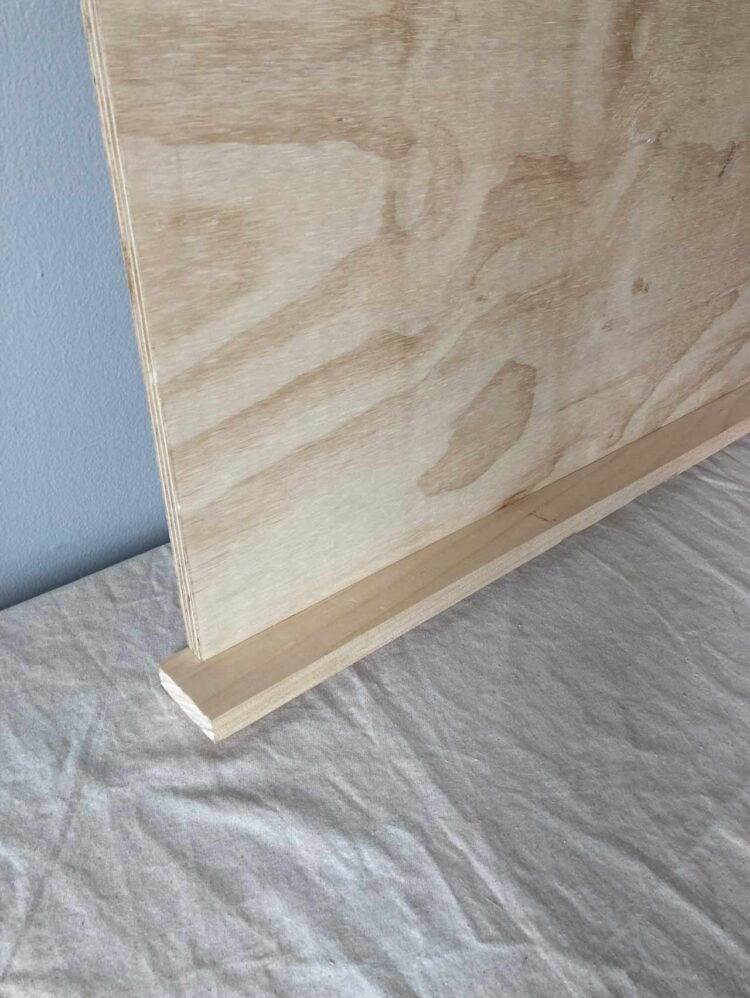 10   Drill holes in the plywood where your dowel pins were marked, glue in the holes and along the plywood spine, and join the pieces. It is very important that the top of the plywood and the edge of the 76.5in (194cm) long piece are flush with each other.
