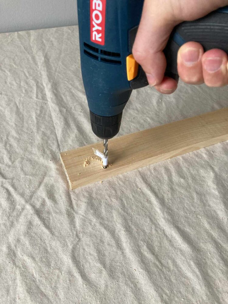 6   In the spot of the pilot hole, drill a hole up to the mark made in step 5.