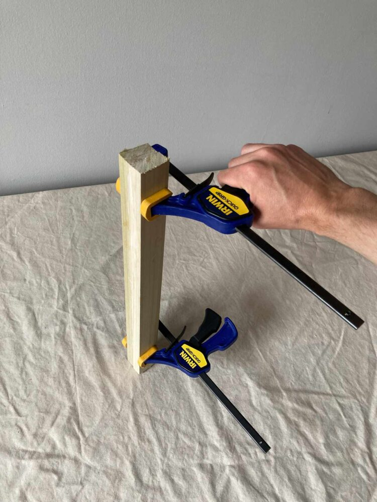 3   Clamp the glued pieces together tightly and let dry. Repeat steps 2-3 two more times, to make 3 total legs.