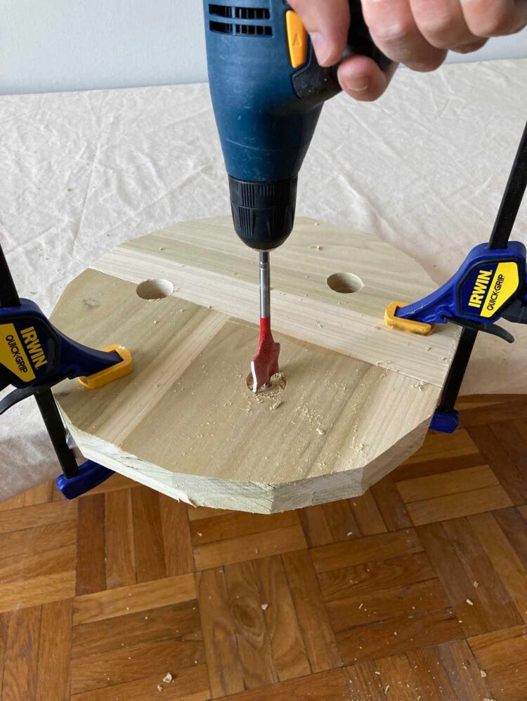 8   Use caution with this step. With two firm hands on the drill, drill 3 holes through the top of the seat and out the bottom of the seat. Each hole angled outward.