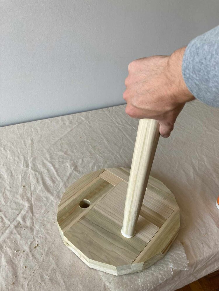 9   Apply glue to the legs and twist through the seat holes until the leg emerges out the other end.