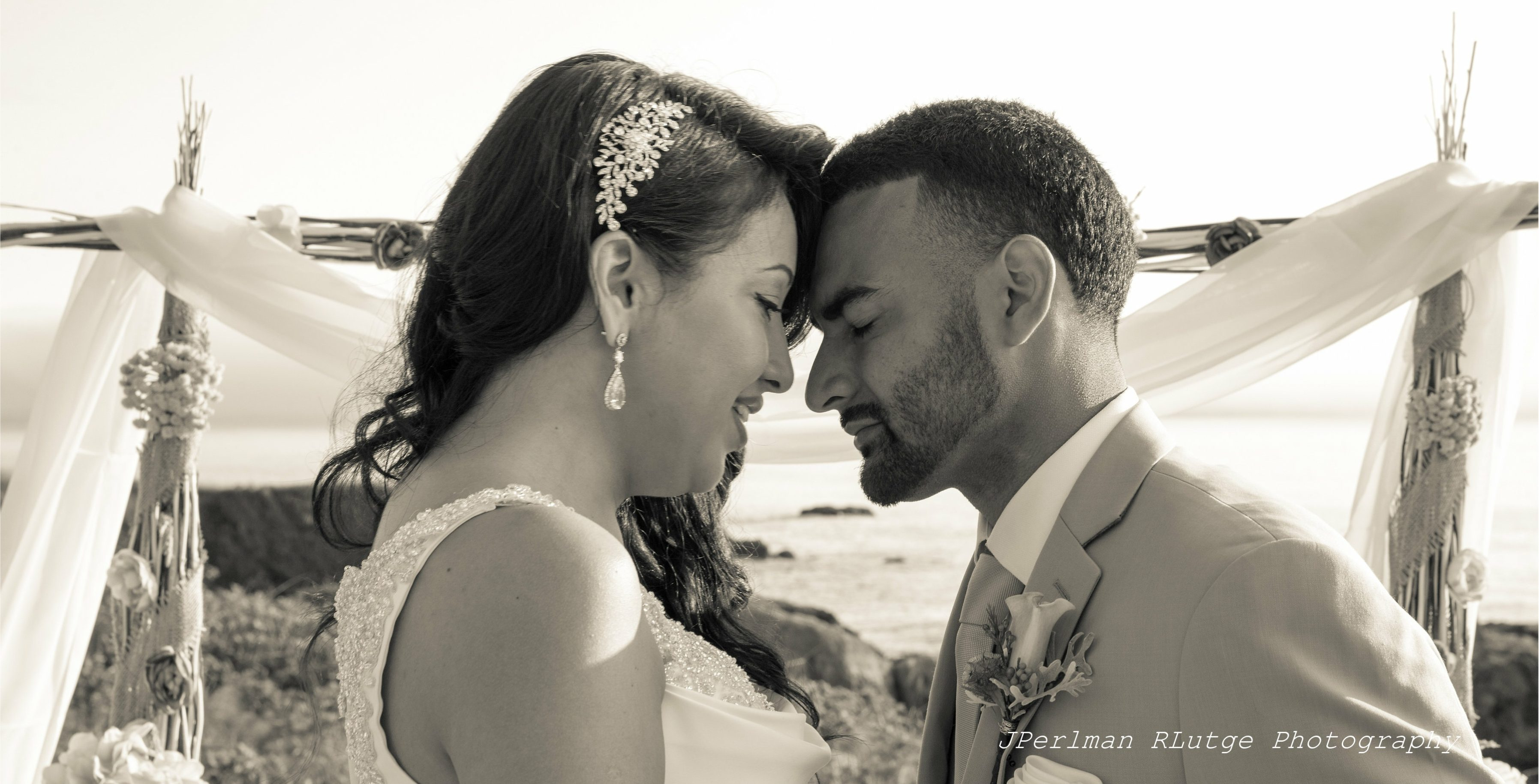 Johana and Issac, bride and groom, embrace at the beach in Westport, California shortly after their wedding by Elope Mendocino.