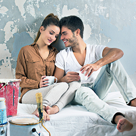 Image of couple painting walls of home