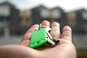 Picture of a person with keys to a home in their hands