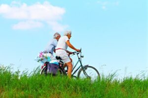Image of an elderly couple riding bikes
