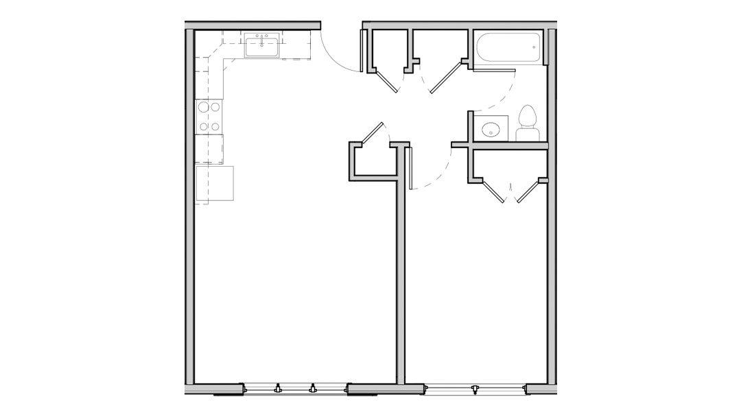 Open kitchen and living space with bedroom and bathroom on one side.