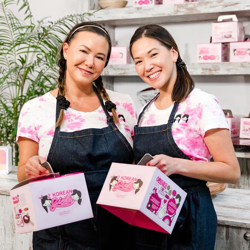2 Korean Girls holding the cutest dinner box