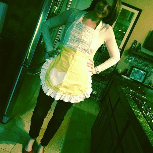 Heidi St. John in a yellow Sugar Baby Apron