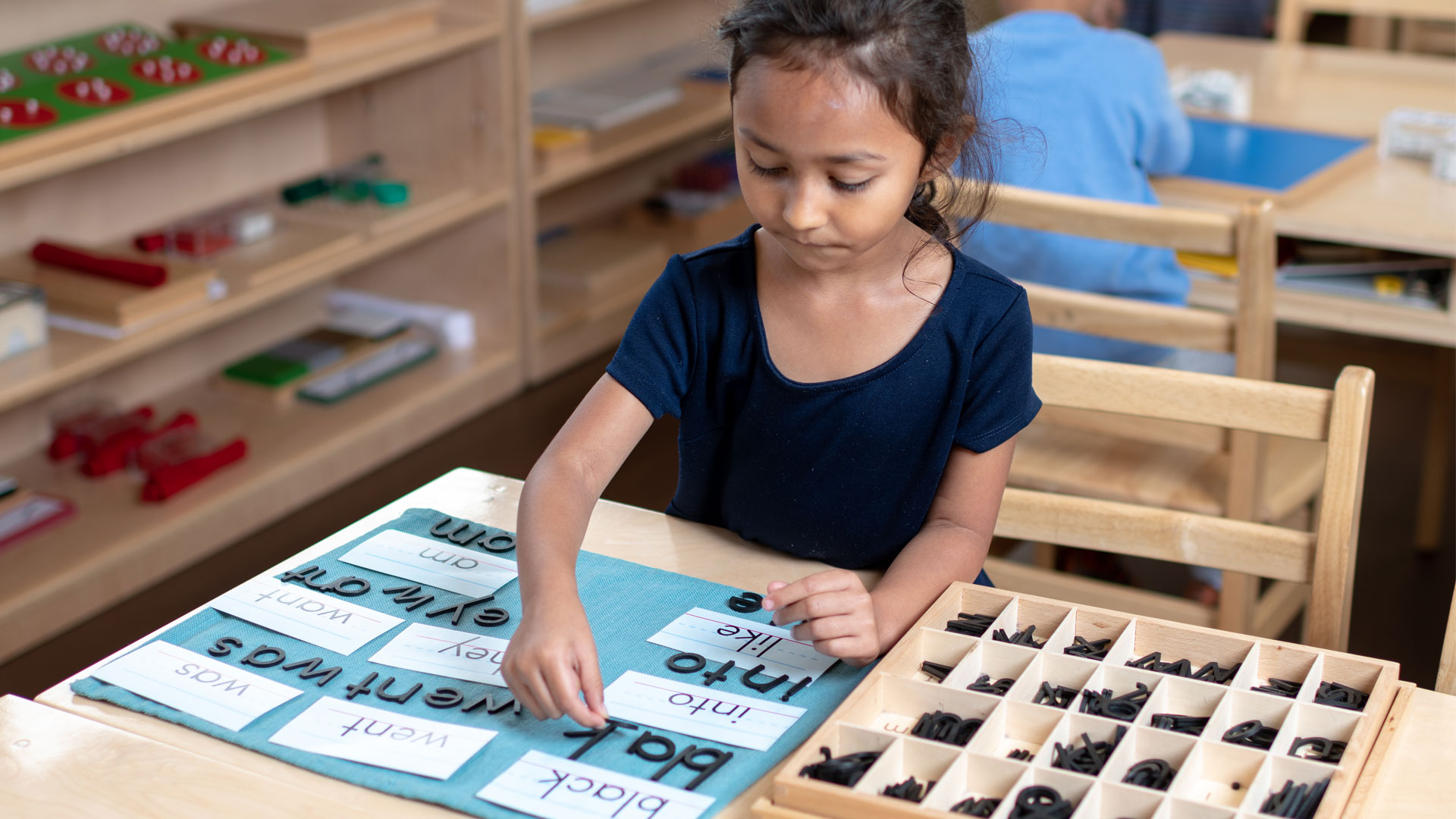 A girl playing with letters