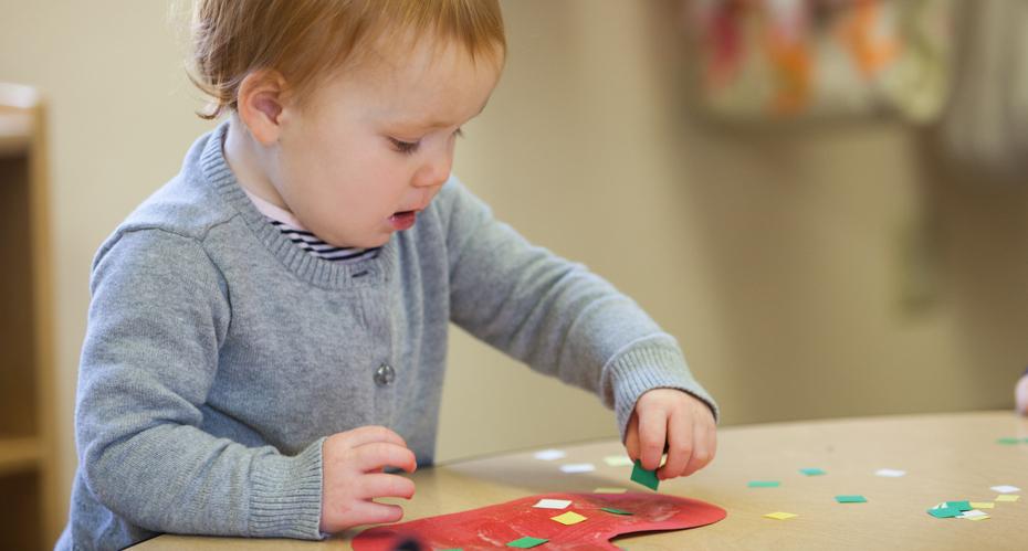 A toddler doing art