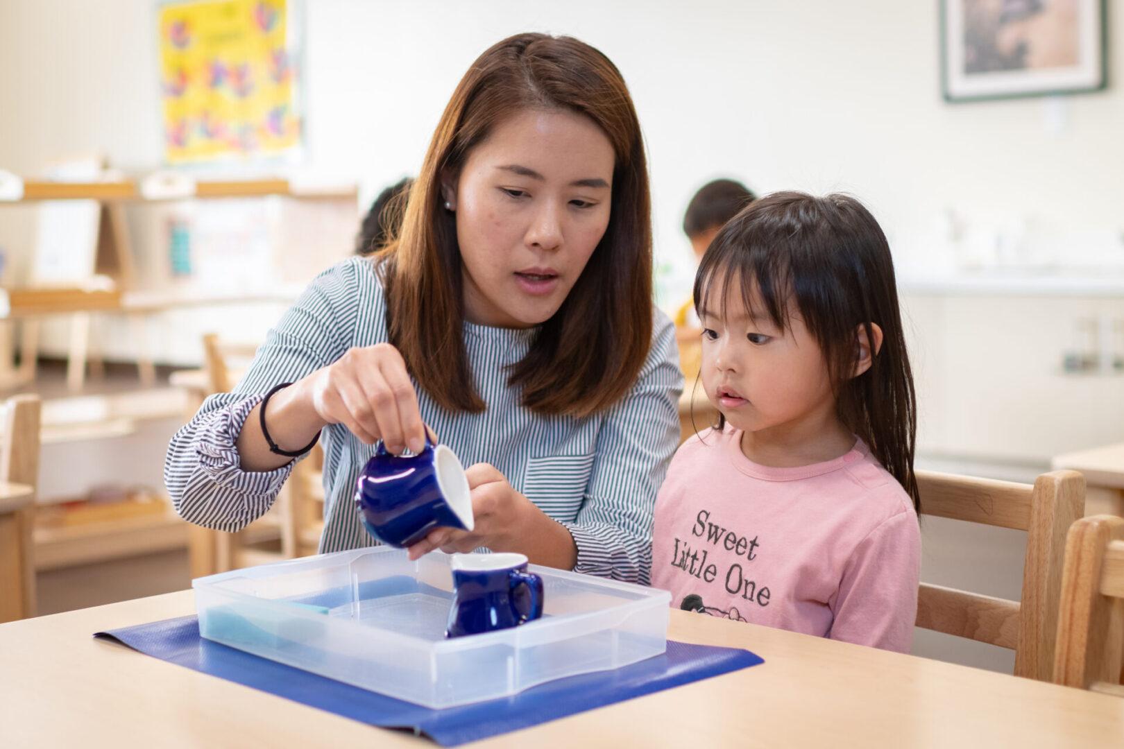 : A teacher guiding her student