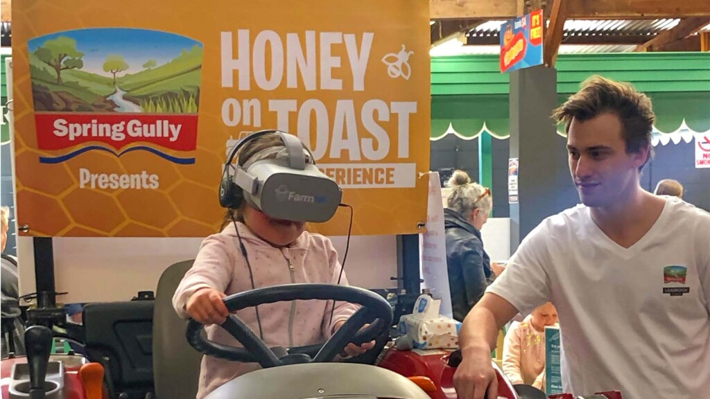Think Digital Event Activation kid wearing VR headset watching tractor simulator 360 video experience
