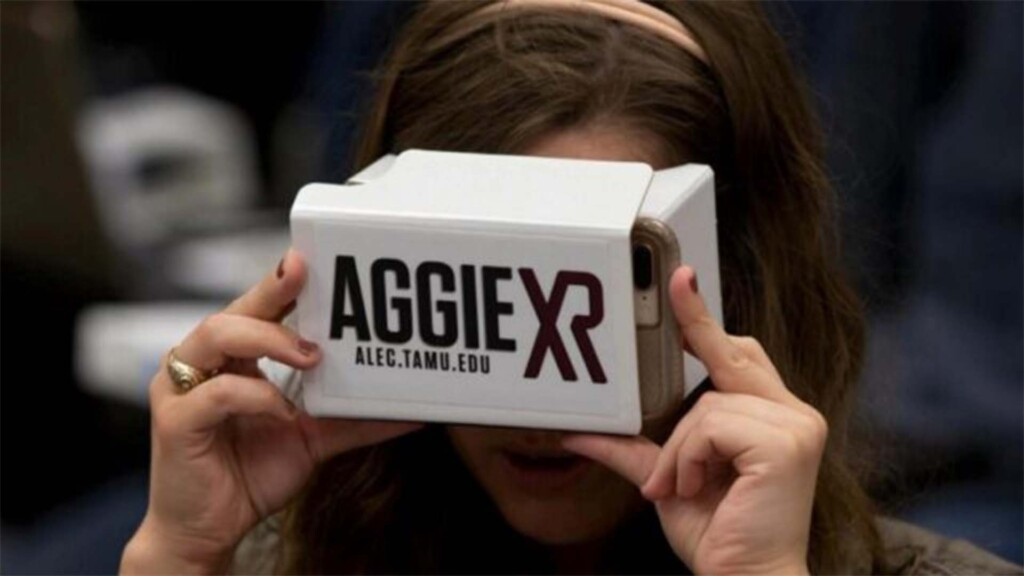 Person using AggieXR branded virtual reality cardboard headset
