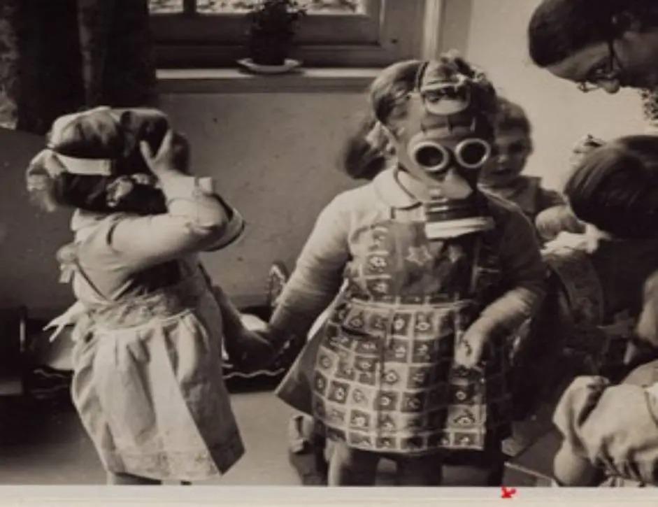 Children wearing gas masks