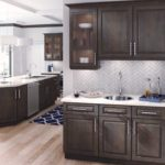 granite countertop wetbar with traditional wood cabinets