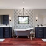 Wapoint - Maple Navy bath cabinets with claw foot tub