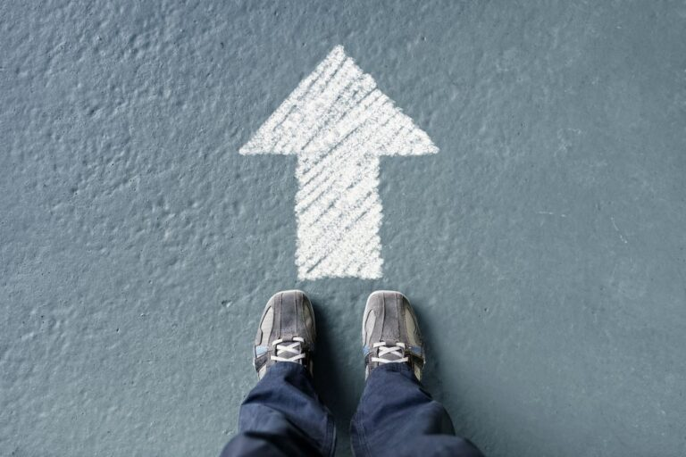 Man standing with forward direction arrow