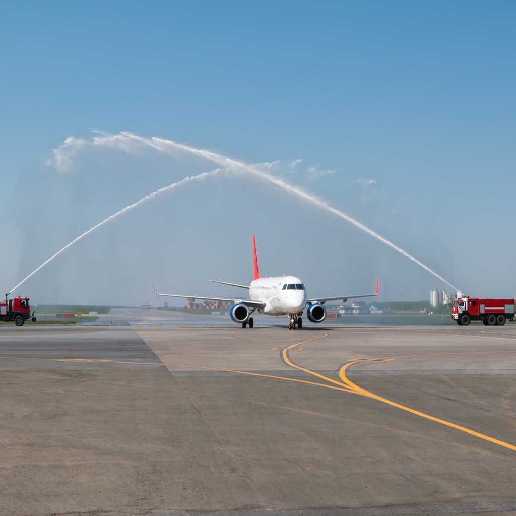 First flight of new airline passes under water salute given by ARFF engines