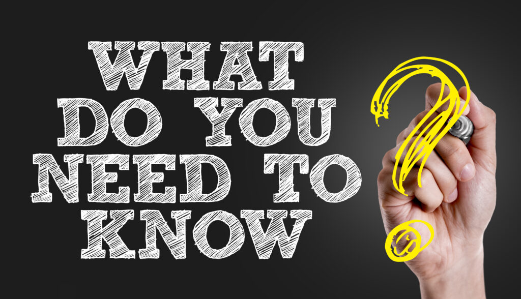 Hand writing the text: What Do You Need to Know?
