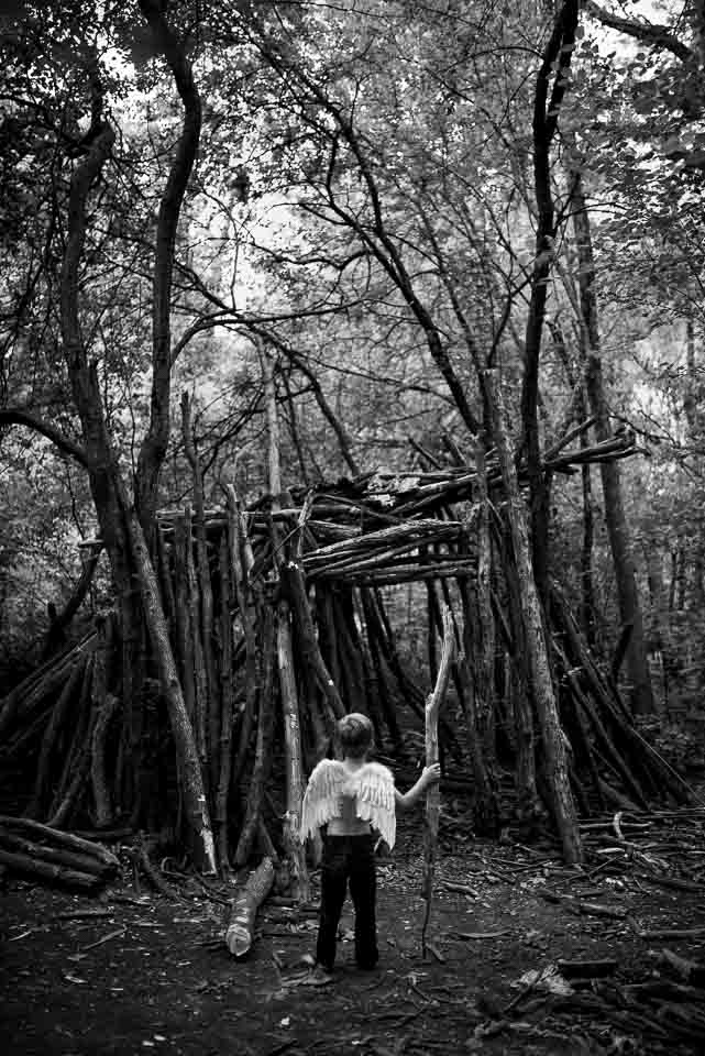 child-with-angel-wings-forest-hut