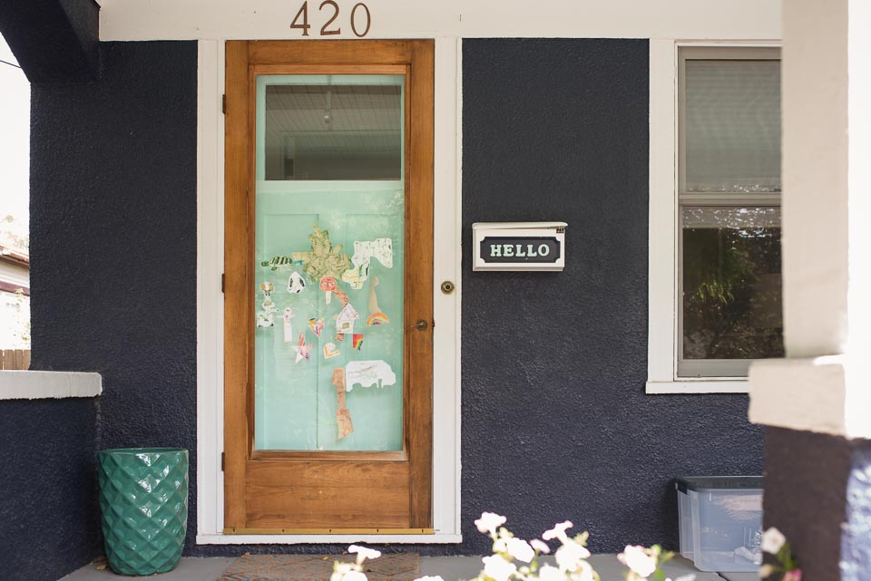 Grand Rapids family documentary photographer image of home front door covered in childrens art