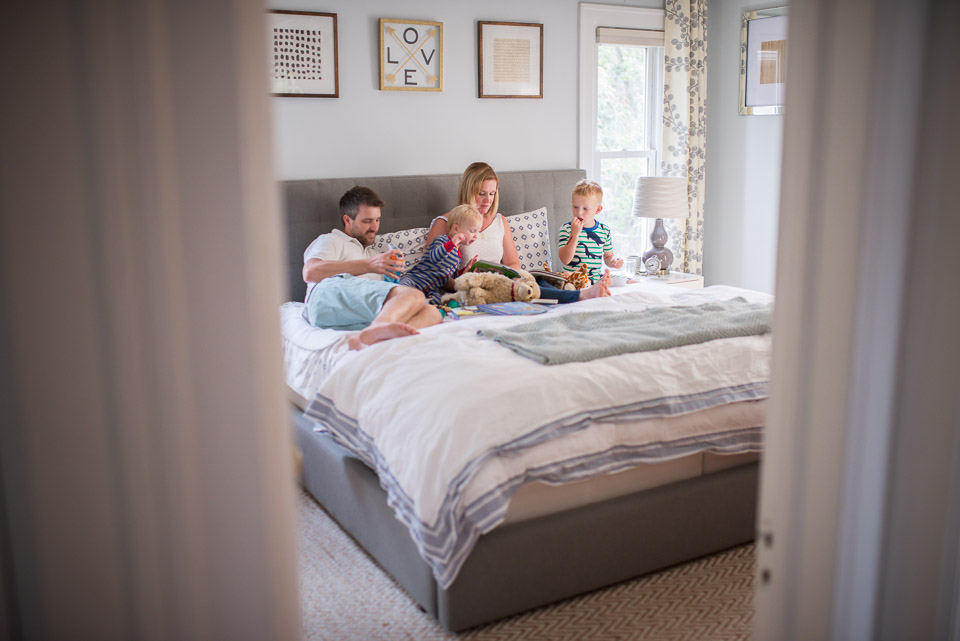 East Grand Rapids family cuddles and reads books at bed time during a family photography session