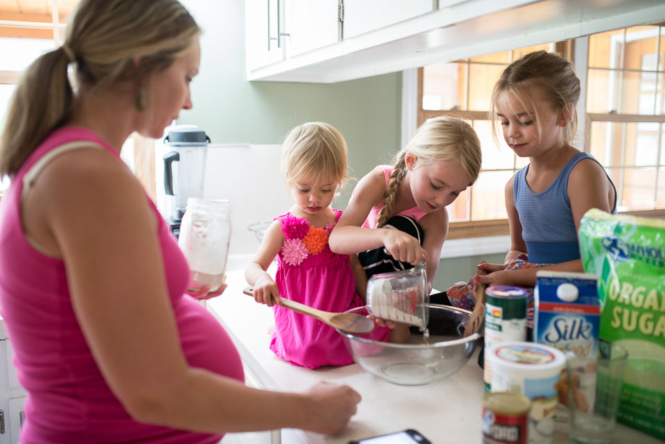 Family documentary session image of a Grand Rapids family making chocolate chip cookies