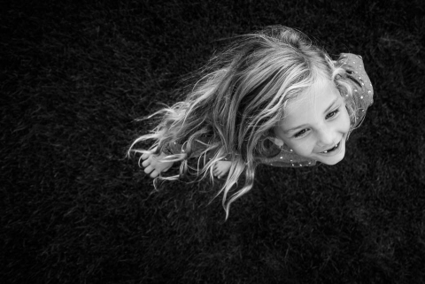 Flowing hair and strinking black and white characterize this artistic child portrait
