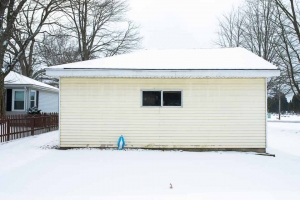 blue-shawled-madonna-behind-snowy-garage